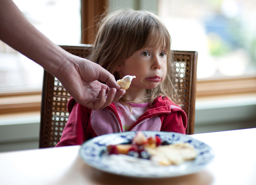 A picky eater refuses food at the dinner table. (Lynn Koenig/Getty Images)